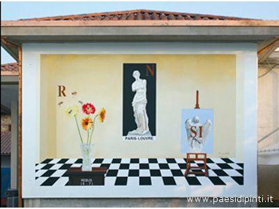 Un rebus dipinto sulla parete di un'abitazione