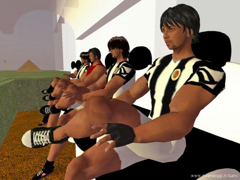 I giocatori ascoltano seduti in panchita quello che dice il mister