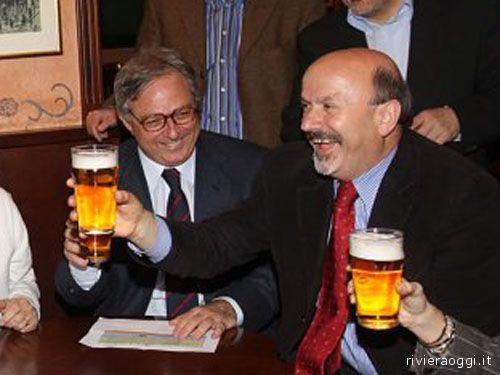 Spacca e Ucchielli (segretario regionale del Pd sostenitore dell'accordo con l'Udc) brindano alla vittoria elettorale. Sono loro due i principali vincenti delle elezioni regionali 20101