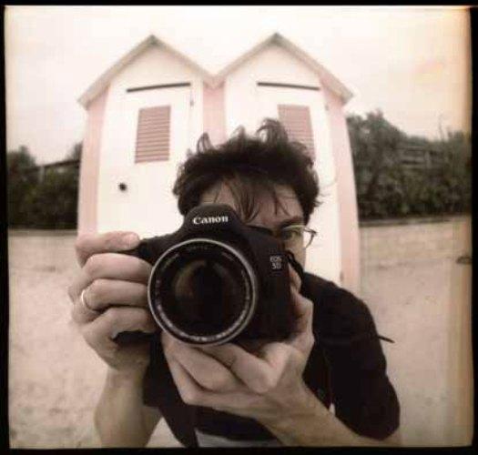 Il fotogiornalista in una immagine del fotografo Domenico Oddi