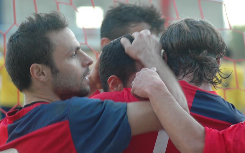 Gol di Di Vicino, sotto l'abbraccio dei compagni Marini e Napolano (ph. Giammusso)