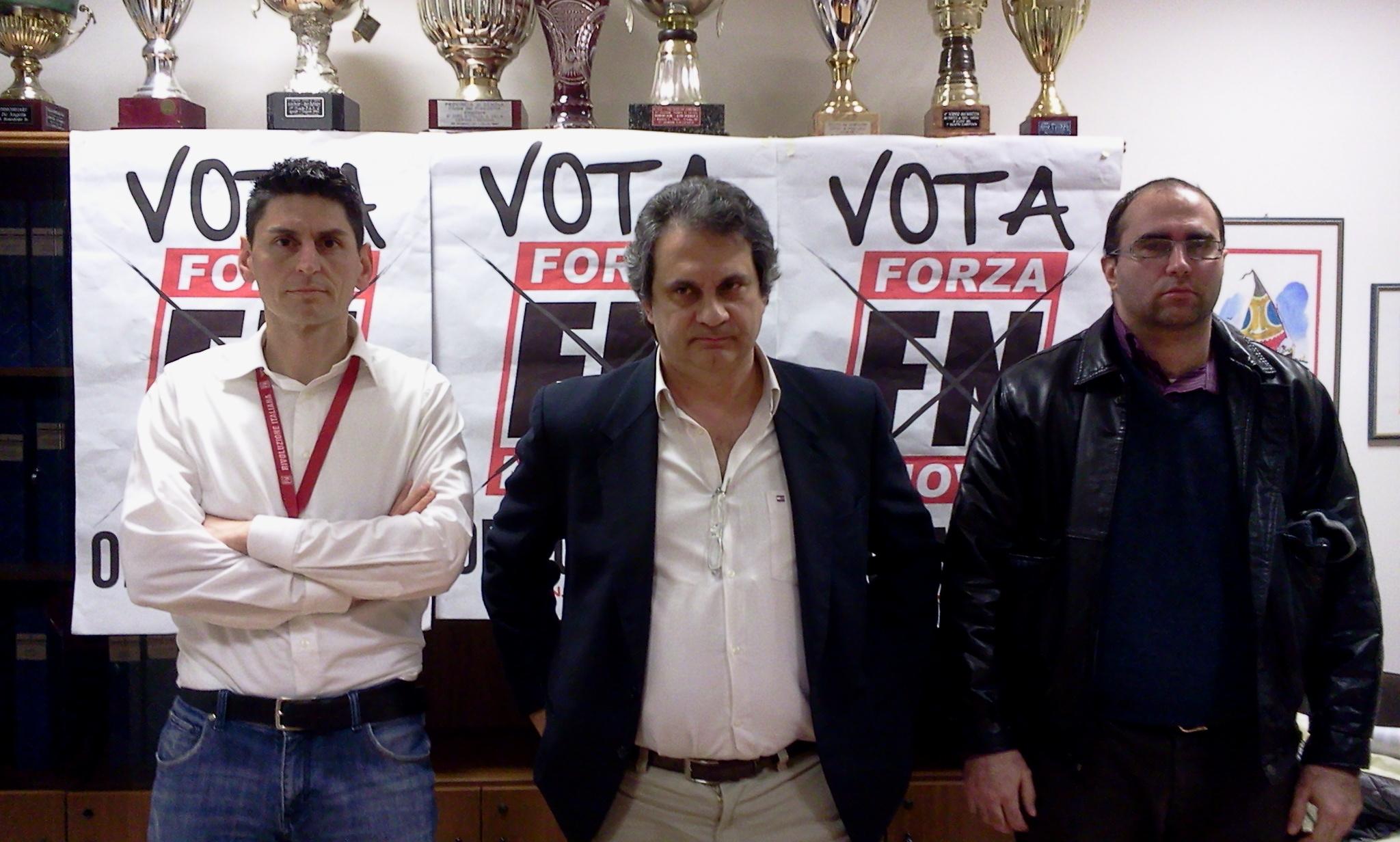 Al centro, Roberto Fiore