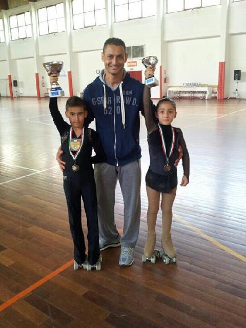 Kevin Bovara e Alba Marconi con il loro allenatore Ivan Bovara