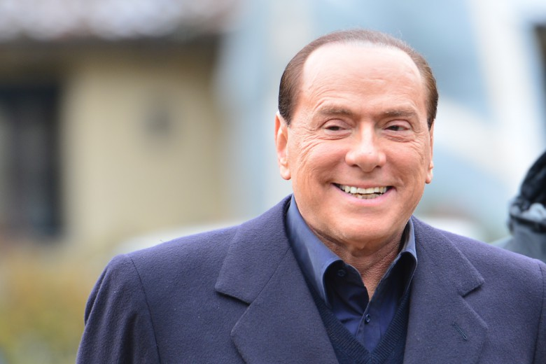 Italian former prime minister and owner of the AC Milan football team, Silvio Berlusconi, arrives at the AC Milan training grounds in Milanello on December 8 , 2012. Prime Minister Mario Monti's government hung by a thread the day before as predecessor Silvio Berlusconi prepared to return to the fray, with his supporters arguing that Italy is now far worse off than before. AFP PHOTO / GIUSEPPE CACACE        (Photo credit should read GIUSEPPE CACACE/AFP/Getty Images)