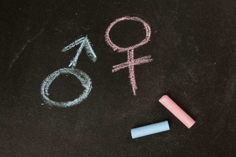 Male and female symbols drawn using chalk on a chalkboard