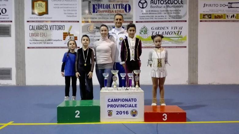 I tecnici Ivan Bovara e Laura Marzocchini con alcuni dei Campioni