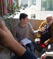 Miguel Sayas e Cristian Bruni intervistano Stelio Bianconi della Cgil, Riccardo Bruni in videocamera